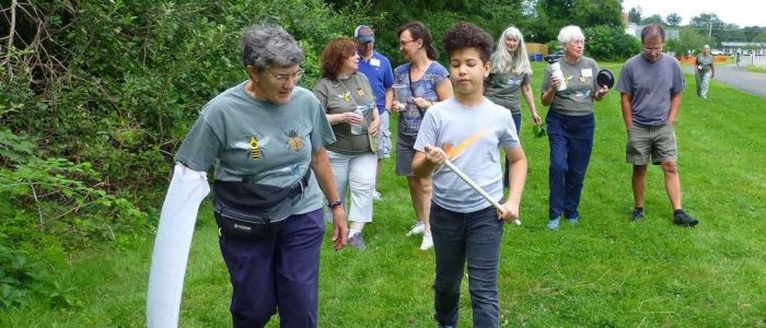 Master Gardener volunteer leading a bug walk